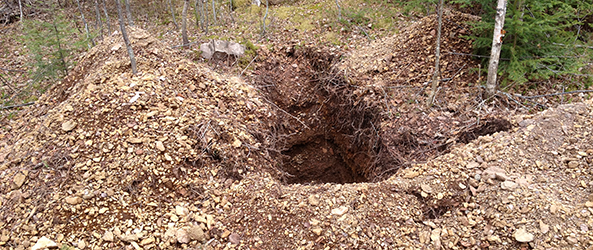A photograph of a test pit.
